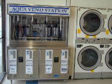 Water Vending Machine Model WS4-BB-3600 installed in Coin Laundry - Mini Water Store - Footprint Size: 2 dryer spaces
